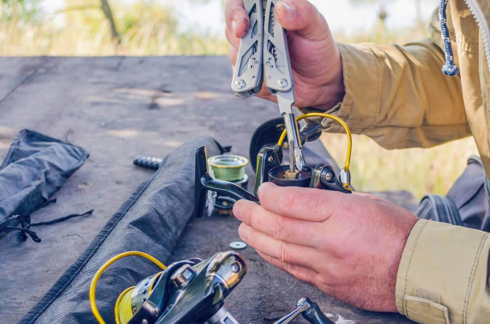 Man Open A Fishing Reel